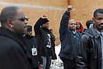 Friends and family raise their fists in solidarity after the casket of housing activist Beauty Turner, 51, a one-time resident of the Robert Taylor Homes who led the Beauty Turner Ghetto Bus Tour and received national recognition in publications such as The Wall Street Journal, is placed into the hearse in the parking lot of the Greater Harvest Missionary Baptist Church on South State Street in Chicago, Illinois on December 26, 2008.  Turner died of an aneurysm on December 18.