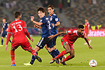 Harib Al Saadi of Oman (R) fights for the ball with Haraguchi Genki of Japan (2nd L) during the AFC Asian Cup UAE 2019 Group F match between Oman (OMA) and Japan (JPN) at Zayed Sports City Stadium on 13 January 2019 in Abu Dhabi, United Arab Emirates. Photo by Marcio Rodrigo Machado / Power Sport Images