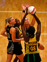 17.1.2014 New Zealand's Leana De Bruin, right, and Katrina Grant compete for ball with Jamaica's Jhaniele Fowler during their netball test match in London, England. Mandatory Photo Credit (Pic: Tim Hales). ©Michael Bradley Photography.