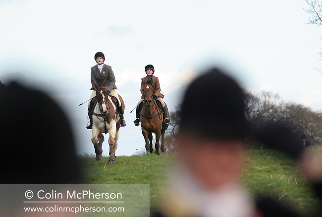 Members of the Wynnstay Hunt ride out at their first meet since the ban on hunting with dogs came into force. Around 130 horses rode out with two dogs, staying within the new law. The Wynnstay Hunt, named after Sir Watkin Williams-Wynn, dated back to the 18th century and hunted on country estates in Shropshire, Cheshire and north Wales. Hunting with dogs in England and Wales became illegal on 18th February 2005 despite legal challenges to the ban and many hunts vowed to continue the ancient sport of foxhunting, risking prosecution.