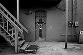 Cleveland, Ohio<br /> USA<br /> July 16, 2010<br /> <br /> A crucifix  painted on the backdoor to the Brighterside Neighborhood Community building in intercity Cleveland.