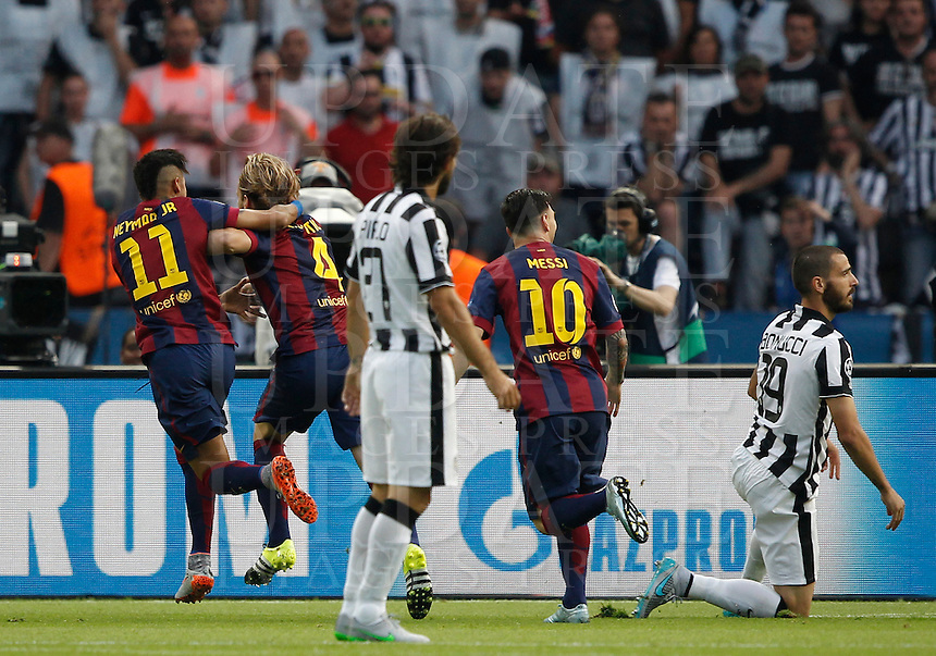 Calcio, finale di Champions League Juventus vs Barcellona all'Olympiastadion di Berlino, 6 giugno 2015.<br /> FC Barcelona's Ivan Rakitic, second from left, celebrates with teammates Neymar, left, and Lionel Messi, second from right, after scoring, as Juventus' Andrea Pirlo, center, and Leonardo Bonucci react during the Champions League football final between Juventus Turin and FC Barcelona, at Berlin's Olympiastadion, 6 June 2015.<br /> UPDATE IMAGES PRESS/Isabella Bonotto