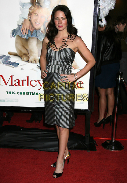 "LYNN COLLINS.""Marley & Me"" Los Angeles Premiere held at the Mann Village Theater, Westwood, California, USA..December 11th, 2008.full length black silver pleats pleated dress hands on hips strapless necklace  .CAP/ADM/MJ.©Michael Jade/AdMedia/Capital Pictures."