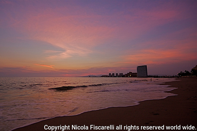 The beautiful early evening sky at the beaches of Puerto Vallarta Mexico.