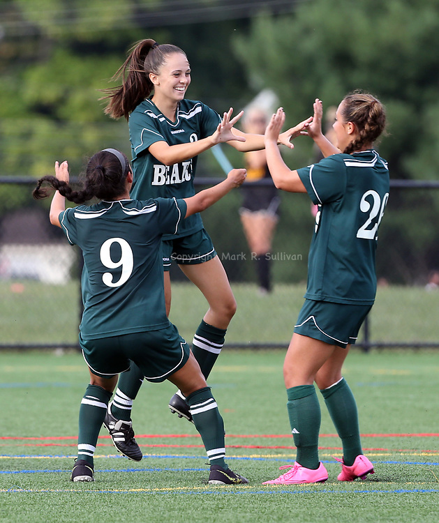 The East Brunswick High School varsity girls soccer take on South Brunswick on Tuesday September 20, 2016 at South Brunswick High School.<br /> East Brunswick's # 3 (center) Gina Morrison celebrates with tame mates after scoring a 1st half goal.