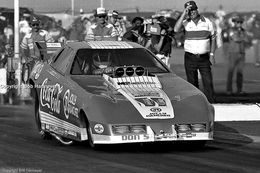 POMONA, CALIFORNIA: John Force drives his Funny Car during a 1985 NHRA drag race at Pomona, California.