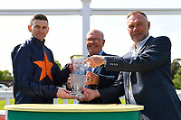 """Jockey Robert Havlin receives the trophy on behalf of owners after winning The Willton Homes """"Confined"""" Novice Stakes (Colts & Geldings) during Afternoon Racing at Salisbury Racecourse on 17th May 2018"""