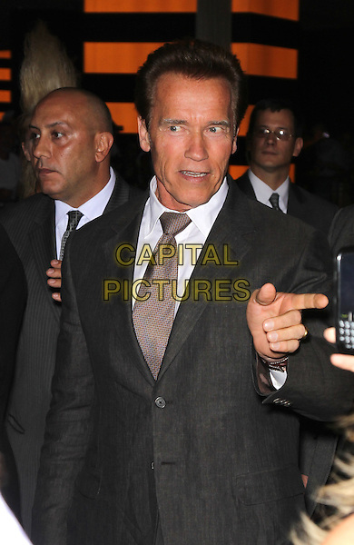 "ARNOLD SCHWARZENEGGER.Special Screening of ""The Expendables"" at Planet Hollywood Resort Hotel and Casino, Las Vegas, Nevada, USA,.11th August 2010..half length grey gray suit tie finger pointing Arnie.CAP/ADM/MJT.© MJT/AdMedia/Capital Pictures."