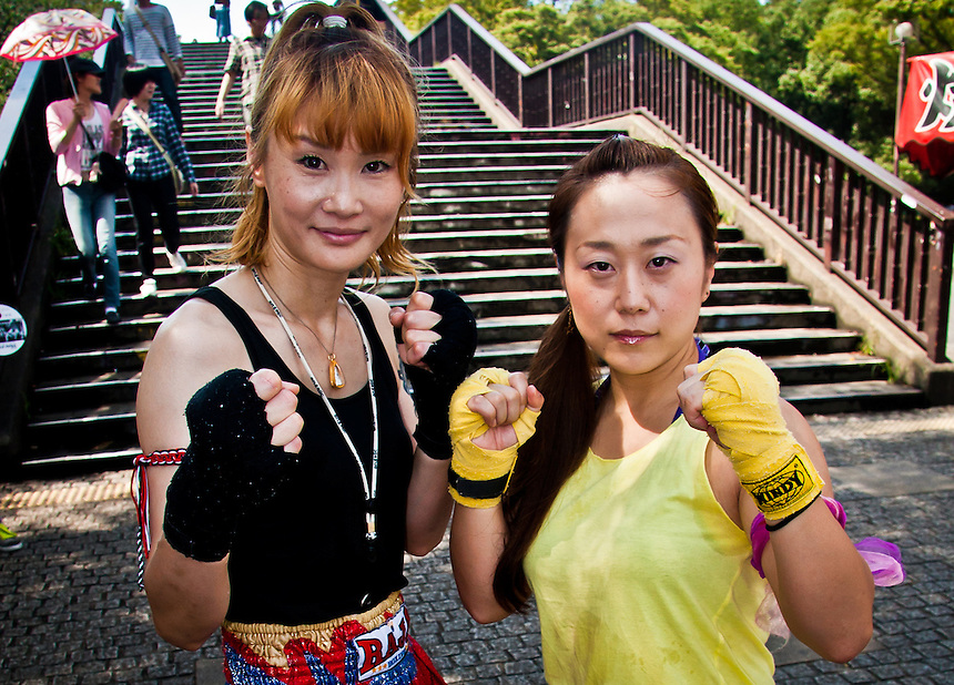 Portrait of a couple of Thai boxing ladies out for a spar in Yoyogi Park, Tokyo.
