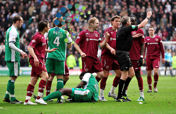 Hearts players surround referee Charlie Richmond to argue that Souleymane Bamba should be sent off during the Hibs v Hearts SPL match at Easter Road Stadium