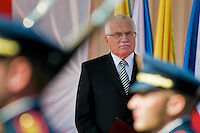 The Czech President Vaclav Klaus watches the Castle Guard during the welcome ceremony upon the Pope Benedict XVI's arrival at the Prague Airport, Czech Republic, 26 September 2009.