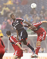 New England Revolution midfielder Shalrie Joseph (21) heads the ball. Chicago Fire defender Austin Berry (22). In a Major League Soccer (MLS) match, the New England Revolution defeated Chicago Fire, 2-0, at Gillette Stadium on June 2, 2012.