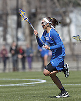 Duke University attacker Brigid Smith (6) brings the ball forward. Boston College (white) defeated Duke University (blue), 10-9, on the Newton Campus Lacrosse Field at Boston College, on April 6, 2013.