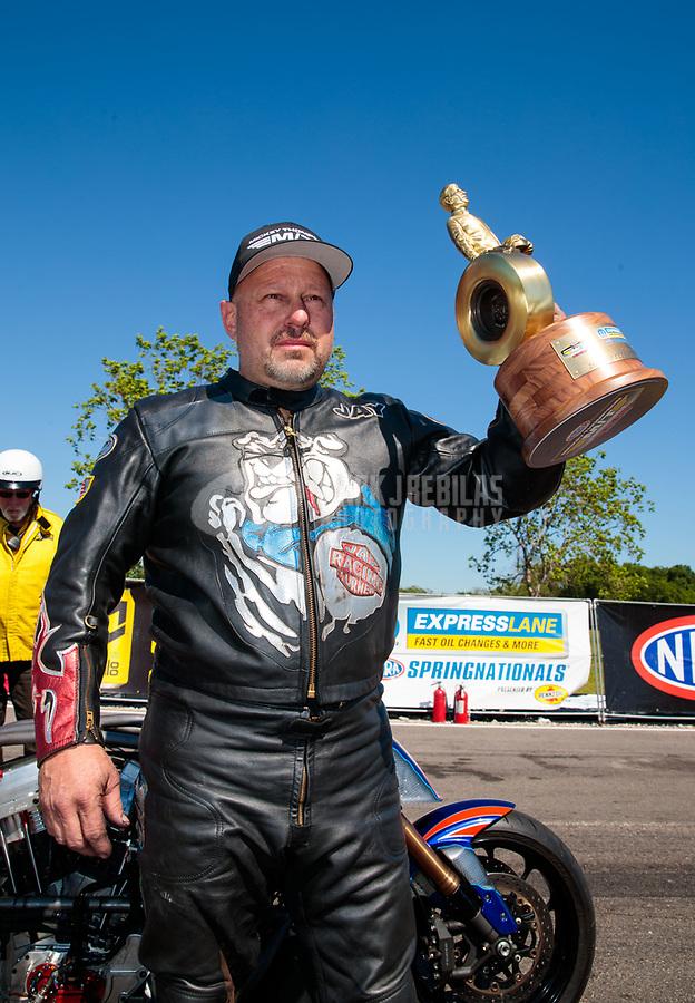 Apr 14, 2019; Baytown, TX, USA; NHRA top fuel Harley Davidson nitro motorcycle rider Jay Turner celebrates after winning the Springnationals at Houston Raceway Park. Mandatory Credit: Mark J. Rebilas-USA TODAY Sports