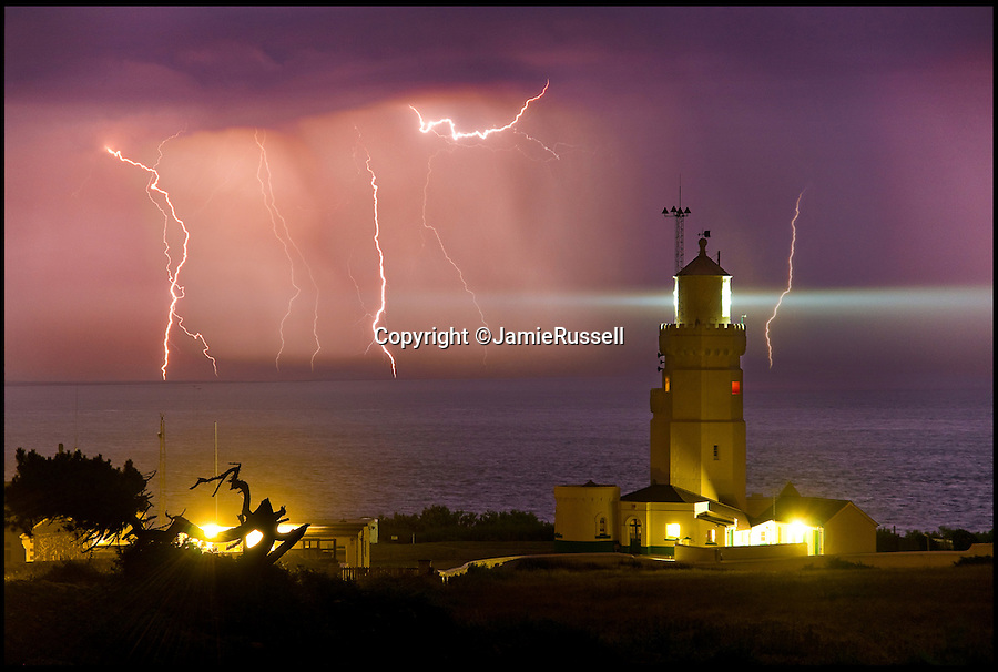 BNPS.co.uk (01202 558833)<br /> Pic: JamieRussell/BNPS<br /> <br /> ***Please Use Full Byline***<br /> <br /> Lightning storm over St Catherines lighthouse. <br /> <br /> Stunning photographs have revealed a turbulent side to the normally genteel Isle of Wight.<br /> <br /> The seemingly benign south coast holiday destination has been catalogued over a stormy year by local photographer Jamie Russell, and his astonishing pictures reveal the dramatic changes in weather that roll across the UK in just 12 months.<br /> <br /> Lightning storms, ice, floods, gales and blizzards have all been captured by the intrepid photographer who frequently got up in the middle of the night to capture the climatic chaos.<br /> <br /> Looking at these pictures prospective holidaymakers could be forgiven for thinking twice about a gentle staycation on the south coast island.