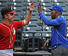 Patrick Abate, catcher and captain of the Amityville varsity baseball team, left, high fives Donovan Mitchell, New York Mets Director of Player Relations and Community Outreach, during a visit to Citi Field in Flushing, NY by Abate and his teammates on Saturday, June 23, 2018.
