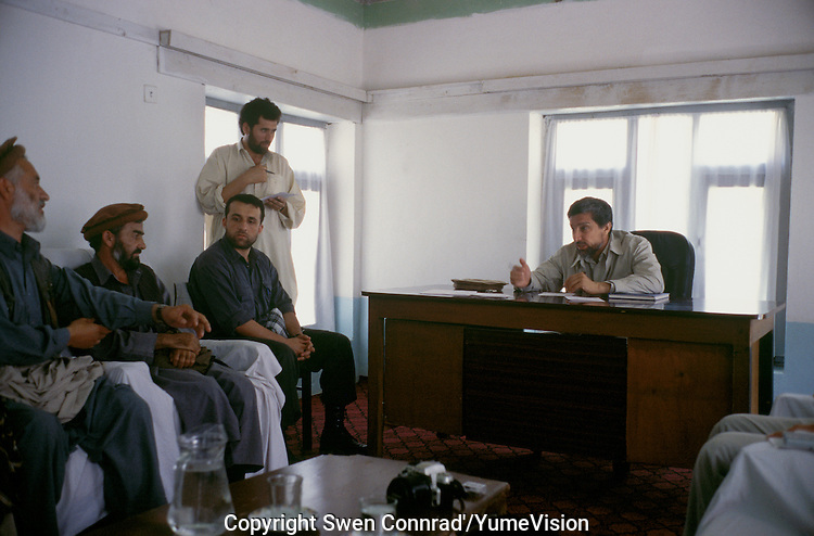 """Warlord Ahmad Shah Massoud in is office of Khoaja Bahauddin few days before is assassination in the same seat..He received daily local Afghan or foreign guest. On the left seat, Amrullah Saleh, Massoud intelligence aide..Ahmed Shah Massoud was born in Jangalak in the Panjshir Valley in 1953. He attended the university in Kabul where he studied engineering. The invasion of Afghanistan by the Soviet Union in 1979 changed the course of Ahmed Shah Massoud's life. .Massoud become a Mujahidin in the 80 and one of the most brilliant military strategists. Arrive the 90 and the civil war, Massoud turn in to a warlord, how loot and kill thousands of Afghan Muslim civilians. .He die the 09 September 2001 in the explosion of a camera with two fake journalist..Hours later, after Massoud had been evacuated to Tajikistan, his intelligence aide Amrullah Saleh called the CIA's Counterterrorist Center. He spoke to Rich, the bin Laden unit chief. Saleh was sobbing and heaving between sentences as he explained what had happened..""""Where's Massoud?"""" the CIA officer asked..""""He's in the refrigerator,"""" said Saleh, searching for the English word for morgue..Massoud was dead, but members of his inner circle had barely absorbed the news. They were all in shock. They were also trying to strategize in a hurry. They had already put out a false story claiming that Massoud had only been wounded. Meanwhile, Saleh told the Counterterrorist Center, the suddenly leaderless Northern Alliance needed the CIA's help as it prepared to confront al Qaeda and the Taliban..On the morning of Sept. 10, the CIA's daily classified briefings to Bush, his Cabinet and other policymakers reported on Massoud's death."""