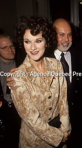 Montreal (Qc) CANADA - circa 1993 file photo of Rene Angelil (R), manager of singer Celine Dion (L) at ADISQ Gala<br /> <br /> Note this is a cropped version (full version also available)