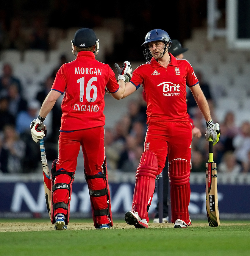 England's captain Eoin Morgan congratulates team-mate Luke Wright on his half century<br /> <br />  (Photo by Ashley Western/CameraSport) <br /> <br /> International Cricket - NatWest International T20 Series - England v New  Zealand - Tuesday 25th June 2013 - The Kia Oval, London <br /> <br />  &copy; CameraSport - 43 Linden Ave. Countesthorpe. Leicester. England. LE8 5PG - Tel: +44 (0) 116 277 4147 - admin@camerasport.com - www.camerasport.com