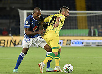 BOGOTA - COLOMBIA, 03-02-2019: Jair Palacios Silva de Millonarios disputa el balón con John Fredy Perez de Bucaramanga durante partido por la fecha 3 de la Liga Águila I 2019 entre Millonarios y Atlético Bucaramanga jugado en el estadio Nemesio Camacho El Campin de la ciudad de Bogotá. / Jair Palacios Silva of Millonarios fights for the ball with John Fredy Perez of Bucaramanga during match for the date 3 of the Liga Aguila I 2019 between Millonarios and Atletico Bucaramanga played at the Nemesio Camacho El Campin Stadium in Bogota city. Photo: VizzorImage / Gabriel Aponte / Staff.
