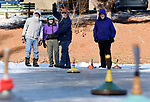Bob Yeager of Glastonbury, center, wills his stone as it slides down the ice The Hartford Saengerbund, a German-American culture organization,  play Eisstockschiessen or Bavarian Curling, Thursday, January 18, 2018,  at Walkers Reservoir in Vernon. Six-members of about 20 who play from the Newington based club braced the cold and wind, on what was agreed to be some of the best ice conditions in several years.  The group brings treats and hot coffee and will spend several hours each visit playing from late morning almost to dusk. The group has been doing this here dating back to 70's, and now just like than,  playing for 25 cents a game. Looking on from left, Larry Tebbets of Andover, Al Medina of Vernon, (Yeager) and Don Ginn of Ellington. (Jim Michaud / Journal Inquirer)