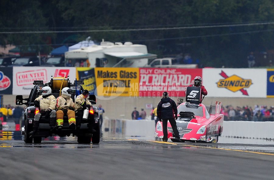 Oct. 1, 2011; Mohnton, PA, USA: NHRA funny car driver Cruz Pedregon climbs from his car after a flat tire during qualifying for the Auto Plus Nationals at Maple Grove Raceway. Mandatory Credit: Mark J. Rebilas-