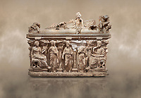 "Roman relief sculpted sarcophagus of Domitias Julianus and Domita Philiska depicted reclining on the lid, 2nd century AD, Perge. Antalya Archaeology Museum, Turkey.<br /> <br /> it is from the group of tombs classified as. ""Columned Sarcophagi of Asia Minor"". <br /> The lid of the sarcophagus is sculpted into the form of a ""Kline"" style Roman couch on which lie Julianus &  Philiska. This type of Sarcophagus is also known as a Sydemara Type of Tomb.. Against a warm art background."