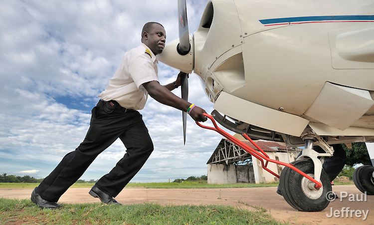 Gaston Ntambo, a United Methodist missionary, pushes a Cessna P210 into a hangar at an airstrip in Kamina in the Democratic Republic of the Congo. Ntambo and the plane are part of the Wings of the Morning aviation ministry of The United Methodist Church, and provide life-saving access to isolated rural communities.