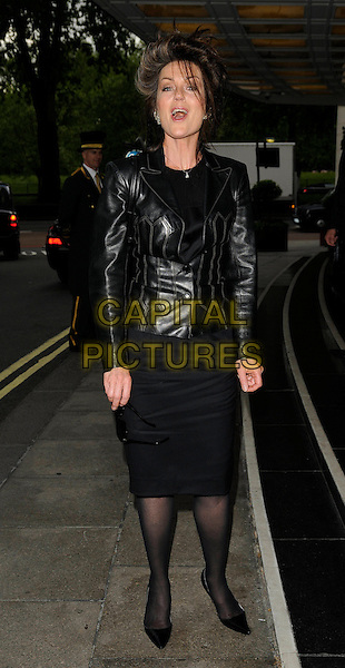 LORRAINE CHASE .The Royston Blythe Hair Salon at The Dorchester Launch Party, The Dorchester, London, England, UK, May 18th 2009..full length black leather jacket skirt tights shoes .CAP/CAN.©Can Nguyen/Capital Pictures