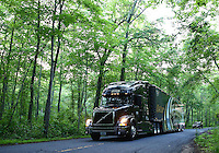 May 29, 2013; Englishtown, NJ, USA: The car hauler of NHRA top fuel dragster driver Khalid Albalooshi drives down Pension Road on its way to Raceway Park. Mandatory Credit: Mark J. Rebilas-