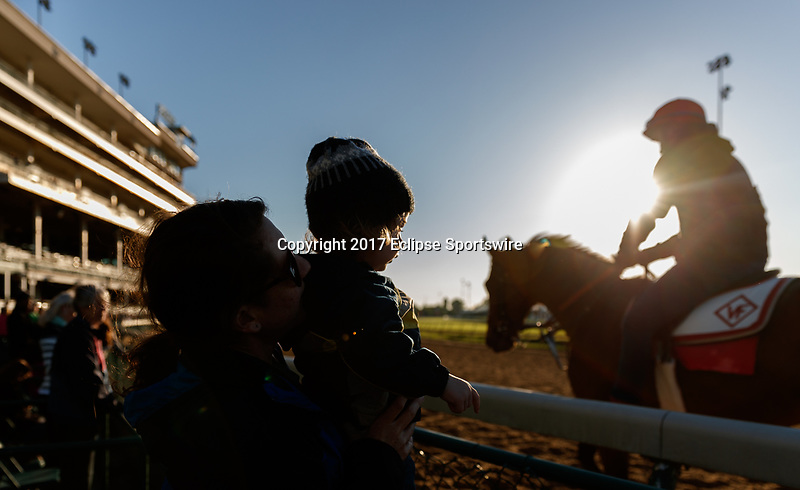 LOUISVILLE, KENTUCKY - MAY 02: Fans watch horses work out at sunrise at Churchill Downs on May 2, 2017 in Louisville, Kentucky. (Photo by Jesse Caris/Eclipse Sportswire/Getty Images)