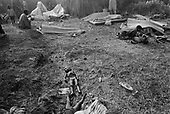 Goma, Zaire<br /> July 1994<br /> <br /> The body of an ethnic Hutu child lays discarded among the living at a refugee camp. <br /> <br /> Following the 1994 Rwandan Genocide, in which Hutu militia groups and the Hutu lead Rwanda military, killed an estimated 800,000 ethnic Tutsis and sympathizers during a 100-day killing spree, 2 million ethnic Hutu?s, fearing reprisals, flee the country. The vast majority went to Goma, Zaire as tens of thousands died in epidemics of cholera and dysentery that swept the roadside crowds and refugee camps. People who had actively participated in the genocide hid among the refugees, fueling the First and Second Congo Wars.<br /> <br /> The international community, and the United Nations in particular, drew severe criticism for its inaction in the wake of the Rwandan Genocide.