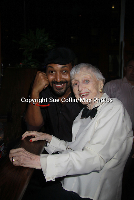 Jesse L. Martin poses with Celeste Holm (Loving) - Stars of Daytime and Prime Time Television and Broadway bartend to benefit Stockings with Care 2011 Holiday Drive  - Celebrity Bartending Event with Silent Auction & Raffle on November 16, 2011 at the Hudson Station Bar & Grill, New York City, New York. For more information - www.stockingswithcare.org.  (Photo by Sue Coflin/Max Photos)
