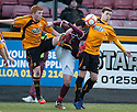 Stenny's Stewart Kean is bundled off the ball by Alloa's Ross McCord and Jason Marr.