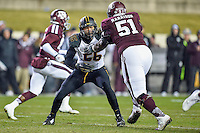 Missouri defensive lineman Shane Ray (56) and Texas A&M offensive lineman Jarvis Harrison (51) during first half of an NCAA football game, Saturday, November 15, 2014 in College Station, Tex. Texas A&M leads 13-6 at the halftime. (Mo Khursheed/TFV Media via AP Images)