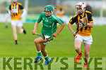 Dylan Moriarty of Ballyduff races forward as Gearóid Quilter of Abbeydorney keeps an eye on him, in the U16 Co Hurling Championship final in Lerrig on Sunday