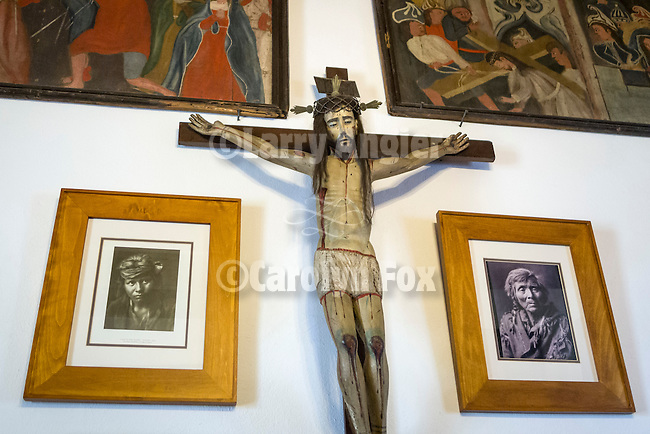 Crucifix and portraits of native Americans in the museum. Mission San Gabriel Arcángel, forth of the 21 California Missions and founded by Father Junipero Serra, September 8, 1771.