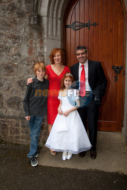 Niki Agrios who made her First Communion Saturday in Termonfeckin Church pictured with mum Marian, dad Demetrios and brother Alex. Picture: Newsfile/Mark Carroll.
