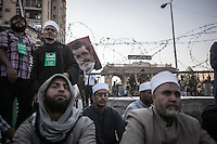 In this Sunday, Jul. 07, 2013 photo, members of the Muslim Brotherhood demostrate against the detention of the ousted president Mohammed Morsi during a rally at the Republican Guard Headquarters in cairo, Egypt. (Photo/Narciso Contreras).