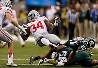 Ohio State Buckeyes running back Carlos Hyde (34) gets tackled by Michigan State Spartans defensive end Shilique Calhoun (89) and Michigan State Spartans safety Kurtis Drummond (27) during the first half of the Big Ten Championship football game at Lucas Oil Stadium in Indianapolis on Friday, December 7, 2013. (Columbus Dispatch photo by Jonathan Quilter)