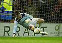 HIBS KEEPER  MARK BROWN SAVES NICKY LAW'S PENALTY TO PUT HIBS THROUGH
