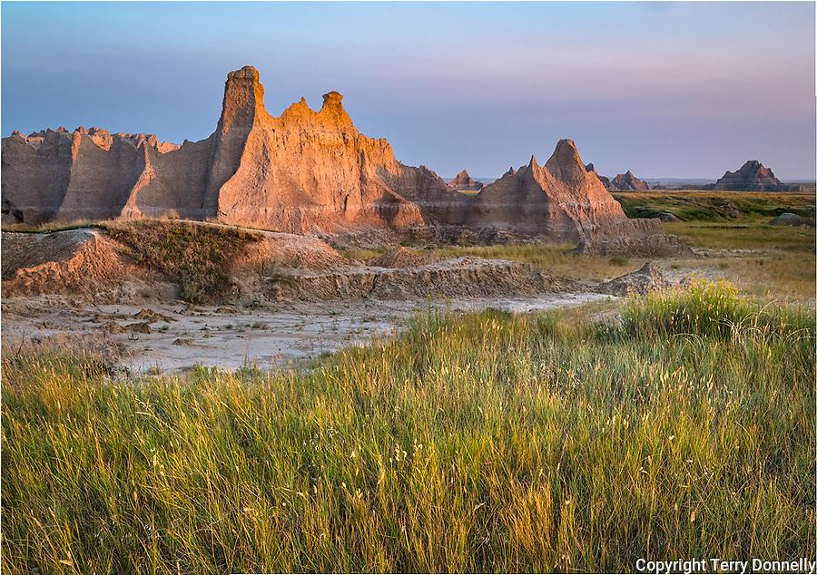 Badlands National Park, South Dakota:<br /> Morning sun on the eroded landforms of the Badlands