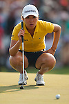CHON BURI, THAILAND - FEBRUARY 19:  In Kyung Kim of South Korea lines up a putt on the 18th green during day three of the LPGA Thailand at Siam Country Club on February 19, 2011 in Chon Buri, Thailand. Photo by Victor Fraile / The Power of Sport Images