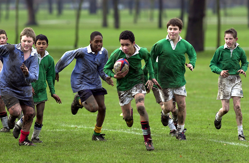 Photo:Ken Brown.22.1.2001 The RFU Youth Development Officers and Trevor Leota through his School of Hard Knocks attempt to recruit players to Rugby from inner-city London. Today they are at Bow Boys School London E3..The boys have a match at the end of training