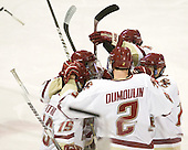 The Eagles celebrate Brian Dumoulin's (BC - 2) goal. - The Boston College Eagles defeated the visiting Boston University Terriers 5-2 on Saturday, December 4, 2010, at Conte Forum in Chestnut Hill, Massachusetts.