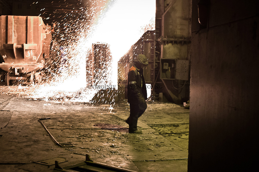 UKRAINE, Mariupol: Cast iron splashing out of he blast furnace. In there, the iron ores are melt at more than 1700 degrees.