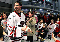 UNO freshman goalie Mike Taffe is all smiles as he leads the team into the lobby of the Qwest Center after UNO's 4-3 comeback win over St. Cloud State Saturday night. Taffe, who relieved starter John Faulkner, stopped 17 shots over two scoreless periods to earn his first collegiate win. (Photo by Michelle Bishop)..