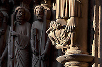 Astrages, King of the Indies, on the base of the statue of St Bartholomew or Nathanael, on the right splay of the central bay of the South Portal. In the distance, St Peter and St Andrew from the right splay of the central bay of the South Portal depicting the Last Judgement, 12th century, Chartres Cathedral, Eure-et-Loir, France. Chartres cathedral was built 1194-1250 and is a fine example of Gothic architecture. It was declared a UNESCO World Heritage Site in 1979. Picture by Manuel Cohen.