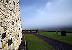 The quartz outer wall at Newgrange, County Meath, Ireland, in a spring snow shower