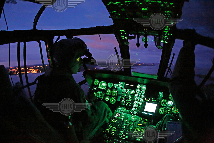 Pilot in check out training, Erik Hals, flying with night vision goggles. Crew from Norwegian Air Force 330 squadron, flying Westland Sea King helicopter. The core mission of the squadron is SAR (search and rescue), but they also fly HEMS (Helicopter Emergency Medical Service), complementing the civilian air ambulance service.<br /> This crew fly out of Rygge Air Station, Norway.
